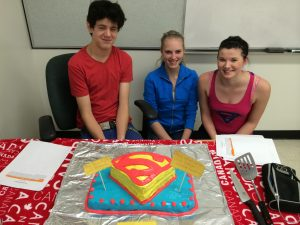 An entry decorated to represent Superman's logo was this red velvet cake made by (left to right) Kristopher Bregenser, Kyla Beaudry and Brittany Fowler of the Watson home ec. class.