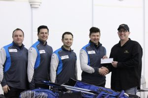 First-place winners were Team Scott Bitz who accepted their prizes provided by Goldline. They are (left to right) Dean Hicke (lead), Aryn Schmidt (second), Jeff Sharpe (third) and Scott Bitz (skip), accepting a cheque from Scott Comfort. The winning team netted $3600 plus $1550 in Goldline merchandise.